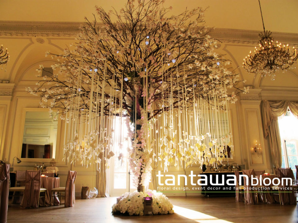 Escort card tree with hanging orchids